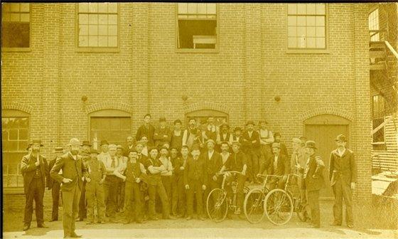 Workers in front of Kesslen Shoe building