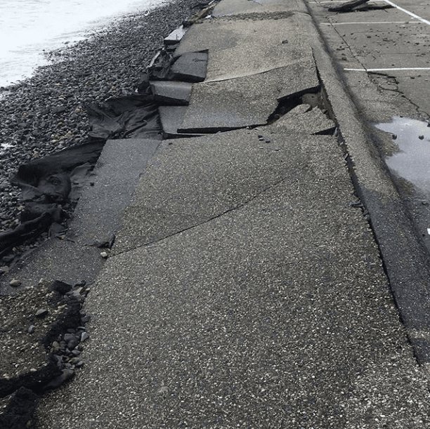 sea wall and sidewalk damage