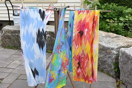 Sumi Scarves at market blowing and hanging